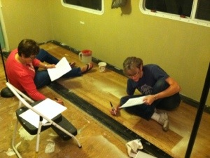 Ladies group - writing Scripture before new flooring - literally STANDING on His Word!
